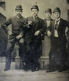 """Wyatt Earp, Warren Earp, Ed Masterson, Bat Masterson. Appearing here l to r on a sixth plate tintype. Warren is moving his hand, obviously """"flicking the ash"""" from his cigarette. Original image from the collection of P.W. Butler."""