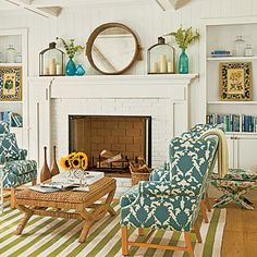 The white brick fireplace and classic mantel of this Lake Michigan cottage sport traditional lines and provide a blank canvas for the homeowner's colorful decor. Coastalliving.com