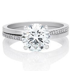 DE BEERS(デビアス)の婚約指輪、デビアス プロミス リング ラウンドブリリアント カットのご紹介です。デュオ シャンクのプラチナ バンドリングにツイストを施した優美なエンゲージメントリング。4つのプロングでラウンドブリリアント カット ダイヤモンドをセットし、サイドにマイクロパヴェ ラウンドブリリアント カット ダイヤモンドを丁寧に配置。【ゼクシィ】なら、DE BEERS(デビアス)のエンゲージメントリングも多数掲載中。