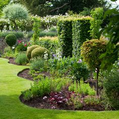 A fun, formal garden.The wave-like border is cute.