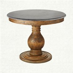 "The Luca Dining Table features a beautiful weathered table base complemented by a stunning bluestone top. The round table measures 39"" in diameter ma"