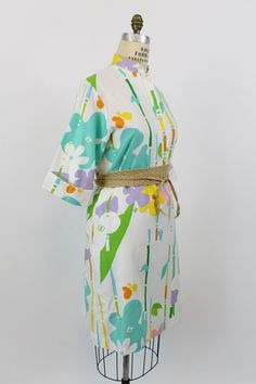 Summery 1960s Catherine Ogust shift! Done in a soft bright cotton material. Bold spring colors make up a floral paint splash pattern. Mandarin
