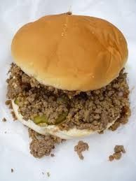 Tastee Burgers!  5 lbs ground hamburger (Serves 25) 1/2 cup ketchup  1/2 cup horseradish 1 tbs salt 1 tbs Worcester sauce 1 cup chopped onion 1 cup water 2 tbs Accent Flavor Enhancer 1 tbs prepared mustard   Brown hamburger in large saucepan and drain. Add everything else, stirring occasionally on low or medium heat for about half an hour. Serve and enjoy!