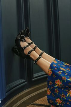 Myriad rebellious youth subcultures inspire Gucci's Resort 2017 collection. Fresh from the runway, these black nappa-leather Queercore pumps feature punkish straps that encase the foot, alongside Victoriana perforations and a host of unexpected embellishments: note the crystal-embellished snake on the high-shine hammered heel, the ornate buckle across the toes, and the signature gold bee embroidered at the back.
