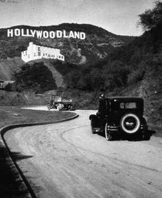 "WELCOME TO HOLLYWOOD The ""Hollywoodland"" sign first appeared in 1923 as an advertisement for a housing development in the Hollywood Hills. Its last four letters — L-A-N-D — were removed in 1949 so that the sign would refer to the neighborhood rather than the development."