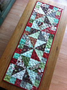 Made from charm packs of Blitzen by Basic Grey and scraps of Fruitcake also from Basic Grey.