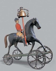 George Brown Horse and Rider Bell Toy
