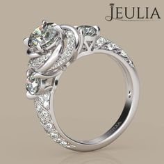 360 view of Jeulia Flower Design Round Cut Created White Sapphire Engagement Ring