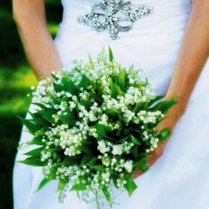 Bride's Bouquet Showcasing: White Lily Of The Valley + Green Foliage