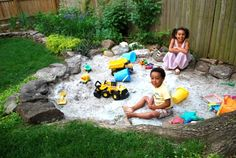 This is the cutest little backyard sand pit!! I think I may have to make this in our back yard.