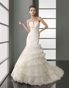 Charming strapless trumpet / mermaid chapel train bridal gowns