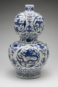 "Philadelphia Museum of Art - Collections Object : Double-Gourd Vase Geography: Made in Jingdezhen, Jiangxi province, China, Asia Period: Ming Dynasty (1368-1644) Date: Jiajing Period (1522-1566) Medium: Porcelain with underglaze blue decoration Citation: Citation: ""The Philadelphia Museum of Art - Double Guard Vase."" Digital image. The Philadelphia Museum of Art - Double Guard Vase. Accessed April 30, 2014. http://www.philamuseum.org/collections/permanent/119882.html?mulR=912662748
