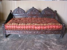 The Triple Arch Jhula Seating line is modelled after the swings from the Maharaja's court. The pieces are hand carved from Neem wood in the Mahogany line. Designed collapsible for simplified transport. Mattresses and cushions sold separately. #IndianDaybed