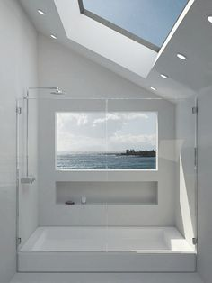 We love all the natural lighting in this #bathroom! The whites and the modern theme is just a dream! www.budgetbathandkitchen.com