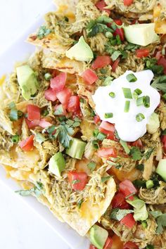 Loaded nachos made with Slow Cooker Chicken Chile Verde, melted cheese, and all of your favorite toppings! These nachos are perfect for game day! Slow Cooker Nachos Recipe, Slow Cooker Recipes, Crockpot Recipes, Chicken Recipes, Cooking Recipes, Meal Recipes, Healthy Chicken, Cooking Ideas, Chicken Chile Verde
