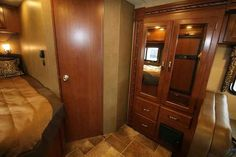 2016 New Thor Motor Coach Four Winds 24C Class C in Indiana IN.Recreational Vehicle, rv, 2016 THOR MOTOR COACH Four Winds24C, 12V Attic Fan in Bedroom, 3 Burner Range w/Oven, Back-up Monitor, Cockpit Carpet Mat, Convenience Package, Exterior-Golden Nugget, Holding Tanks w/Heat Pads, Interior-Rolling Stone, Leatherette Driver/Passenger Chair, Olympic Cherry Cabinetry, Outside Shower, Wheel Liners, Wood Dash Applique,