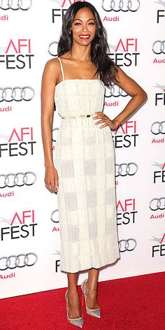 ZOË SALDANA It's not quite as out-there as the checkerboard print everyone was wearing earlier in the year, but Zoë does a subtle version of the pattern in her cream Calvin Klein Collection dress with contrasting embellished material on the skirt at the Out of the Furnace premiere in Hollywood.