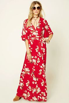 A woven maxi dress by Reverse™ featuring  an allover floral print, a wrap design with a self-tie back, and short bell sleeves.