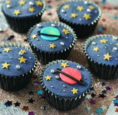 Cupcakes with fondant planets, stars and silver sprinkles on for a space party. Space Party, Space Theme, Space Cupcakes, Planet Cake, Space Baby Shower, Astronaut Party, Themed Cupcakes, Cupcake Cookies, First Birthdays