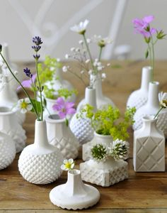 Grouping several single bud vases together can create a beautiful centerpiece.