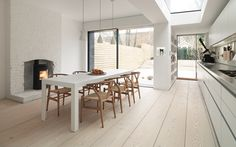 Modern Dining Room with Urbangreen Furniture Parsons Dining Table, Hans Wegner Wishbone Chair, Wide plank hardwood floor Creative Kitchen, Küchen Design, House Design, Nordic Design, Cafe Design, Bulthaup Kitchen, Dressing Design, Interior Architecture, Interior Design