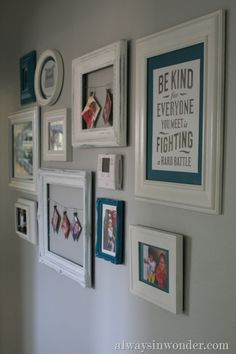 Adorable gallery wall!! Love the frames... And Help hide the ugly thermostat...Using a framed quote is a wall idea and so are the frames with no glass! I didn't even notice it