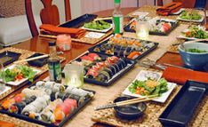 Nice sushi table setting; but I would NEVER put sauce bottles directly on the table. (Especially during a dinner party.) Put the sauce in sake jugs or sauce bowls!