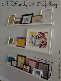 Children's Art Gallery - ikea shelves, frames that can be easily updated (for outside playroom)