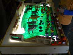 Building our Reggio Emilia Inspired Classroom: A Moment at the Light Table