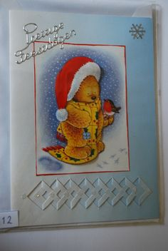 0112, Beer met kerstmuts en Roodborstje