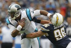 Cam Newton stiff arms Jarret Johnson in the first quarter eluding him on this play.