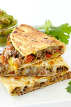 Pan Fried Beef Tacos are browned tortilla tacos filled with meat and melting cheese. Irresistible!