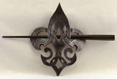 Leather barrette from  https://www.etsy.com/listing/177243648/celtic-fleur-de-lis-leather-steampunk