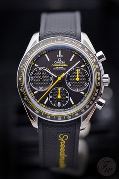 Speedy Tuesday - OMEGA Speedmaster Racing. This week's Speedmaster is the new Speedmaster Racing, a beautiful 40mm Speedy on a black rubber strap with yellow wording and featuring a co-axial chronometer chronograph movement.