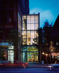 Located at 947 Liberty Avenue, this new loft building houses 3 residential units and a 1st floor storefront. Set in an impossibly narrow lot—only 18-feet wide—the design of the building incorporates a sleek, asymmetric glass façade fronted by an