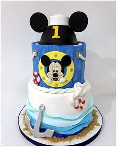 This wonderful Sailor Mickey Mouse Birthday Cake was made by Sweet Brantley Cakes. This is such a beautiful cake. This is a three layer cake. The top layer is carved to look like Mickey Mouse ears. It is wearing a sailors hat and has a red 1 on it. Mickey Mouse Birthday Cake, Mickey Cakes, 1st Birthday Cakes, Gorgeous Cakes, Pretty Cakes, Amazing Cakes, Nautical Mickey, Dream Cake, Cake Board