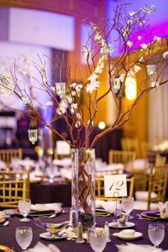 Branch Centerpieces - put hydrangeas at the rim of the vase with some roses - I think that would look really nice