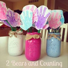 Make these adorable handprint flowers with your kids for a Mother's day gift! You use painted mason jars for the vase as well.