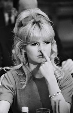 Brigitte Bardot, love the hairstyle with a big bow!