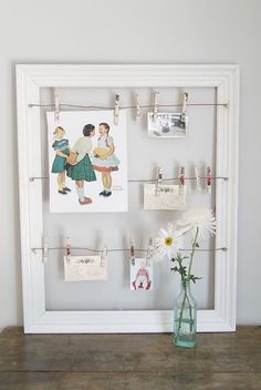 I remember seeing frames like this at Christmas-time to use for holding cards – but I love the idea of using it to show off pictures of the bride/groom. or it could go on the gift table, and ppl could put their cards there instead of in some sort of container (luggage/birdcage, etc).