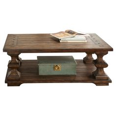 Bring Old World appeal to your living room or home library with this eye-catching coffee table, showcasing carved legs and an open storage shelf.