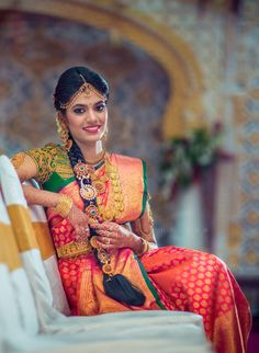 Gorgeous South Indian Bride in Bright Red and Green with Gold Jewelry