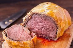 This is Gordon Ramseys version of Beef Wellington....It is an amazing dish...perfect for an elegant dinner party, or perhaps a sophisticated holiday feast! I had to fiddle around with the measurements and temps b/c they were in grams, mils, celsius...etc. This version also is without the pate....I think thats why I decided to give it a whirl!!! Enjoy! :-) Tips: Trim carefully. Lower the chances of the edges separating by giving yourself lots of room - and dont trim the pastry too clo...