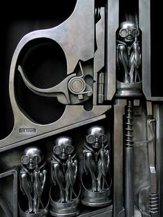 """Gun"", by Swiss surrealist painter, sculptor, and set designer Hans Rudolf ""Ruedi"" Giger. This sculpture is located at the entrance of the HR Giger Museum, Gruyère, Switzerland.    this is so amazing! you have to see this live! i was there a few years ago - amazing expositions"