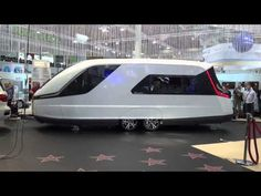 """[w/Videos] 2014 Knaus/Tabbert Caravisio (Germany) Caravan will Cruise You Into the Future - It goes by the name """"Caravisio – The Caravan of the Future"""" and instead of basing its ideas on the conventional, the designers behind it chose to get their inspiration from yachts. This is visible in the exterior look, as well as the layout, which is more boat-like than it is caravan-like."""