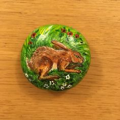 Hare resting, painted on Wharfedale river stone. Nice palm stone.