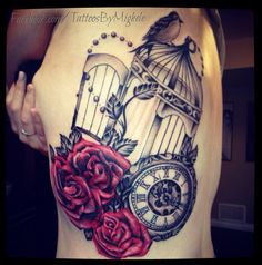 Clock, roses, and birdcage tattoo.