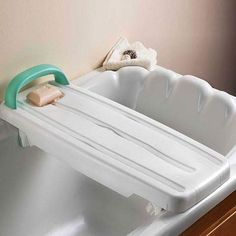A Kingfisher Heavy Duty bath board that features independently adjustable legs (brackets) to secure it to the bath. Drainage holes and a soap dish are moulded into the bath board.  Shop online now : http://ilsau.com.au/product/bath-board-kingfisher-heavy-duty-200kg/    #IndependentLivingSpecialists #ILS #MoblitySolutions #MobilitySolutionsAustralia #BathAids