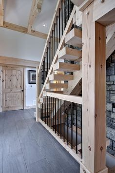 Beautiful white pine staircase, with timber frame accents in the ceiling
