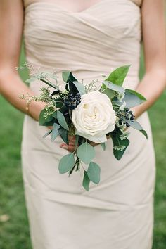 Single-Flower White Rose Bridesmaid Bouquet | Brides.com